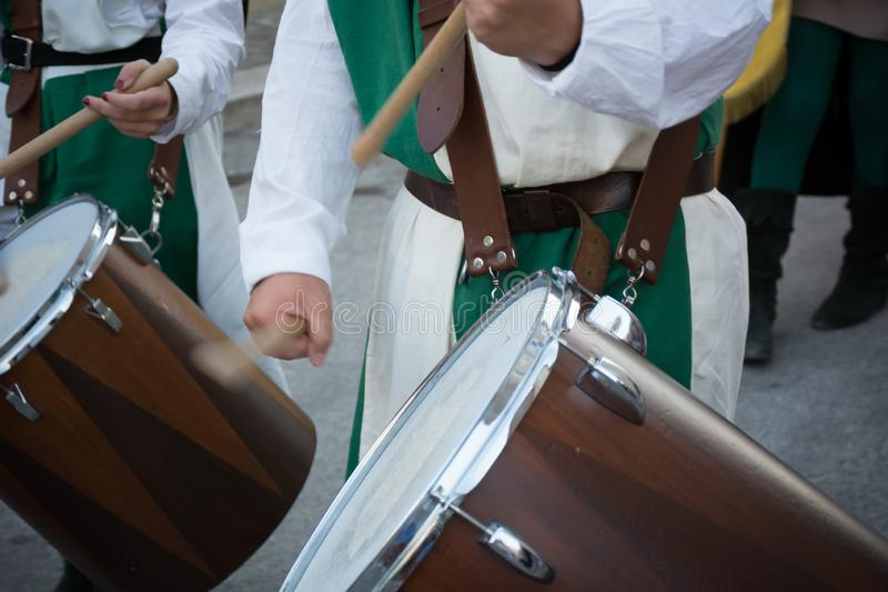 Close Up of Man Playing Drum at Medieval Village Festival stock photo