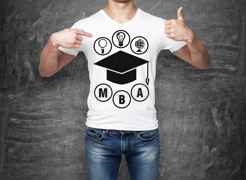 Close-up of a man pointing his finger to the chest with the sketch of the graduation hat. A concept of the MBA degree. shooting mark. Black chalk board on royalty free stock photography