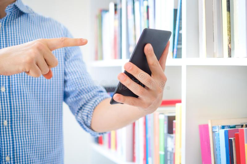 Close-up of a man reading ebook on digital tablet royalty free stock photos