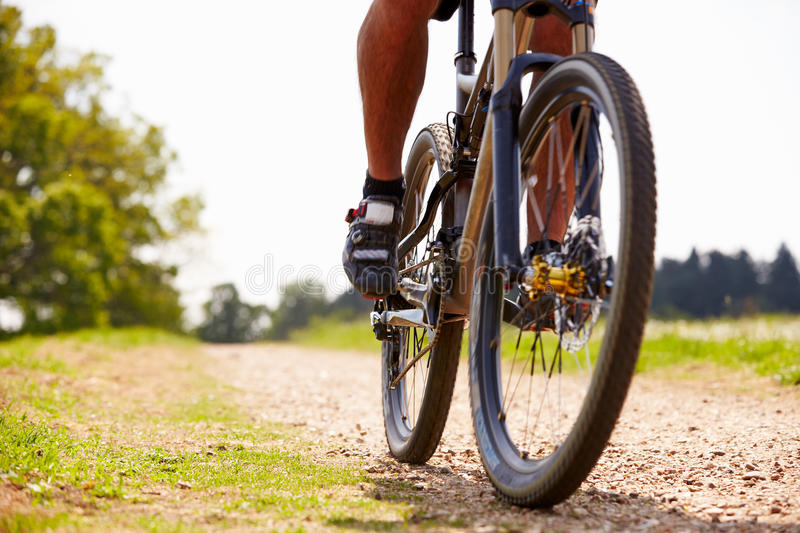 Close Up Of Man Riding Mountain Bike On Countryside Path royalty free stock photo