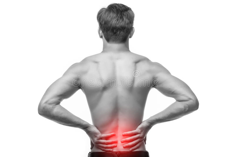 Close up of man rubbing his painful back. Pain relief, chiropractic concept. Close up of man rubbing his painful back stock images