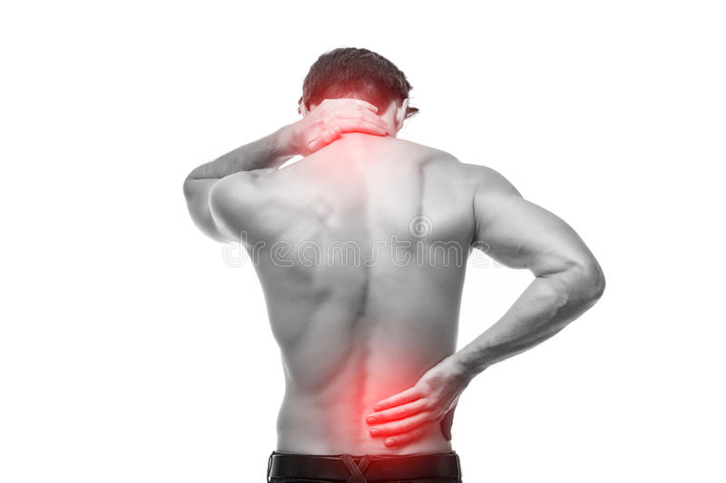 Close up of man rubbing his painful back. Pain relief, chiropractic concept. Close up of man rubbing his painful back royalty free stock images