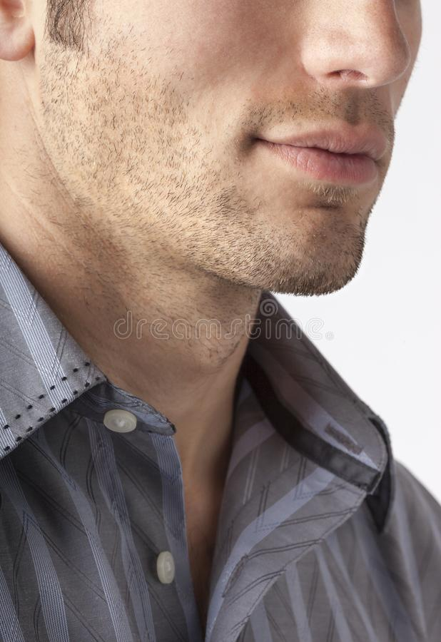 Close-up of man`s chin and jawline with facial hair beard stubble five o`clock shadow. Men`s personal care and grooming stock photography