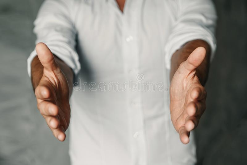 Close up of man`s cupped hands show something on white background. Palms up. High resolution product stock image