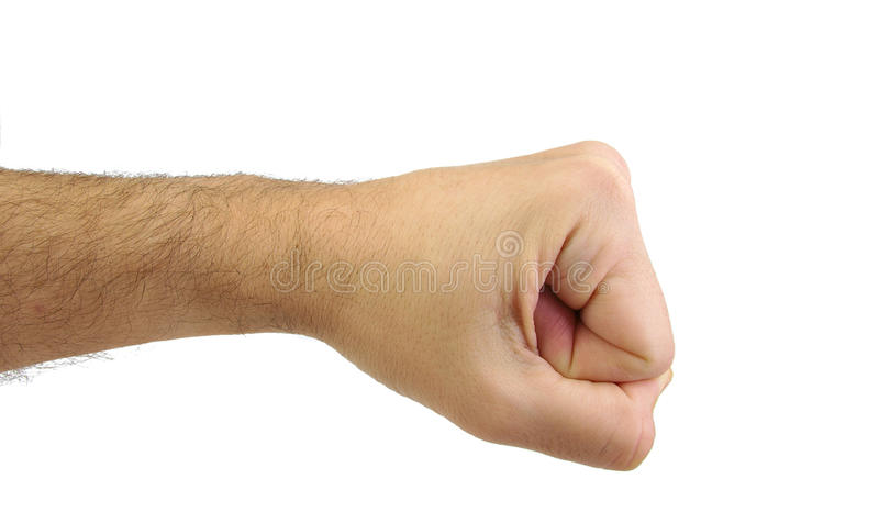 Close up of a man's fist isolated on white. Caucasian man's fist isolated on white background. Punch and confrontation concept stock image