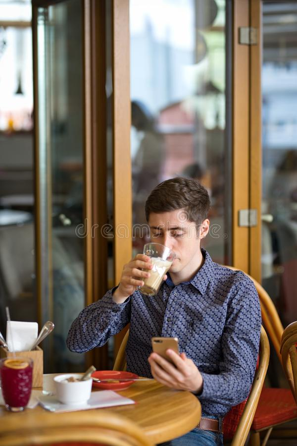 Man with coffee and smartphone royalty free stock photo