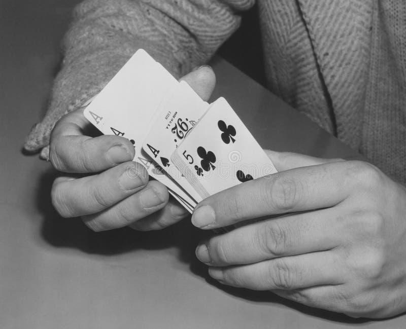 Close-up of man's hands shuffling playing cards stock photos