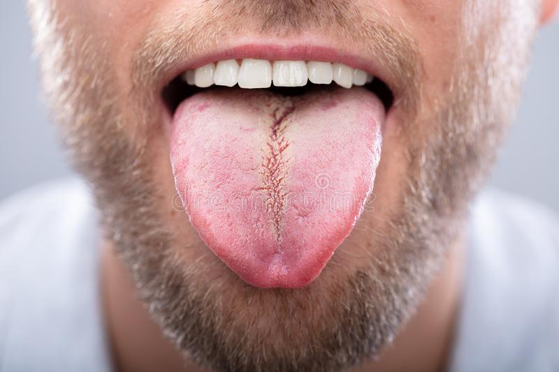 Close-up Of A Man`s Tongue royalty free stock photos