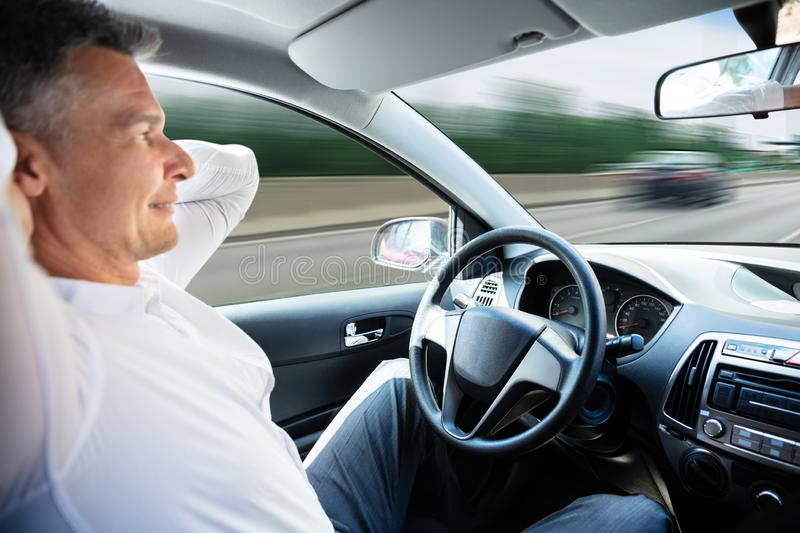 Man In Self Driving Car. Close-up Of A Man Sitting In Self Driving Car royalty free stock photos