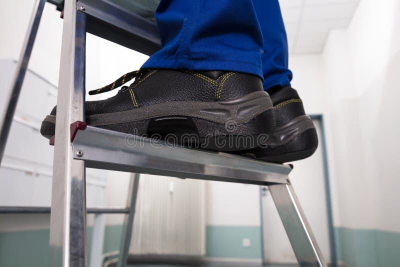 Man Standing On Ladder royalty free stock image