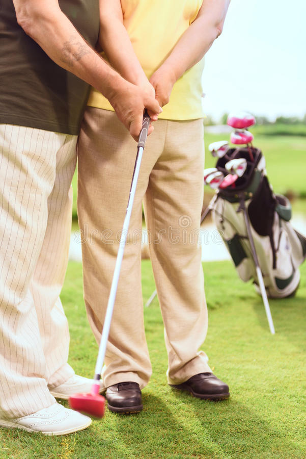 Close up of man teaching to play golf stock photography