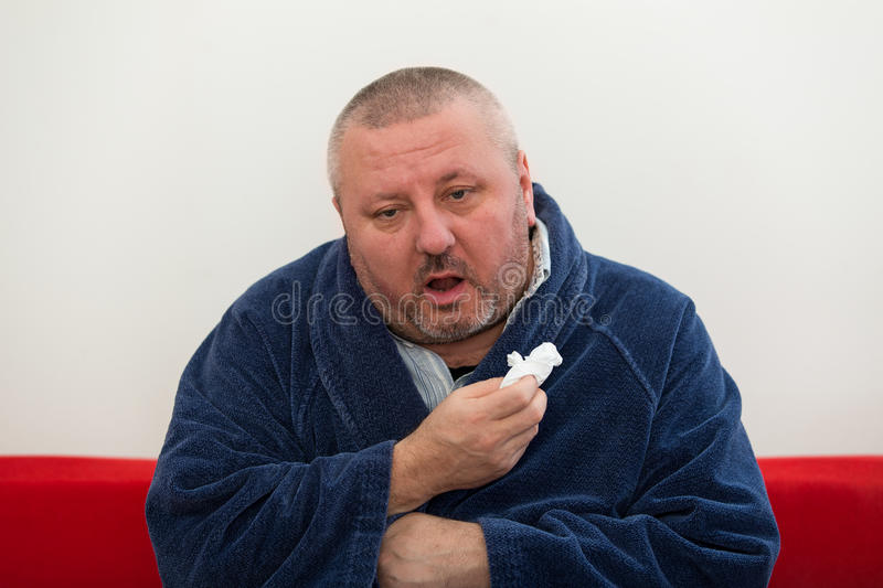 Close-up of a man with tissue in his nose. Close-up of a man with tissue in his nose stock photography