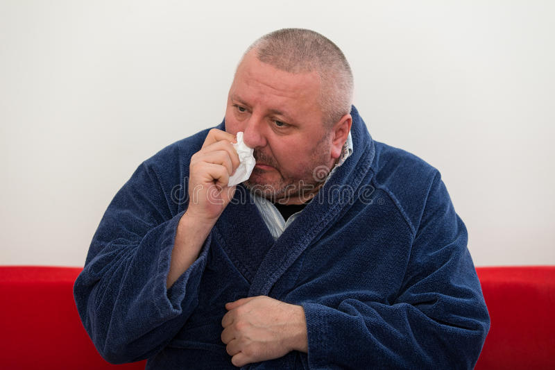 Close-up of a man with tissue in his nose. Close-up of a man with tissue in his nose royalty free stock photos