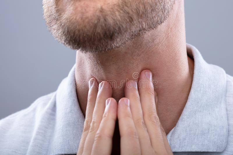 Man Having Sore Throat stock photo