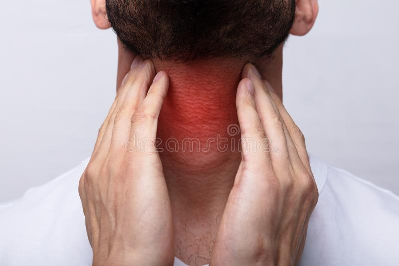 Man Suffering From Sore Throat stock photos