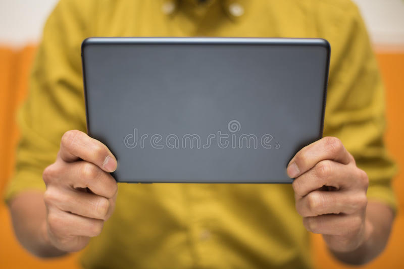 Download Close-up Of A Man Using A Digital Tablet Stock Photo - Image of laptop, reading: 37443076