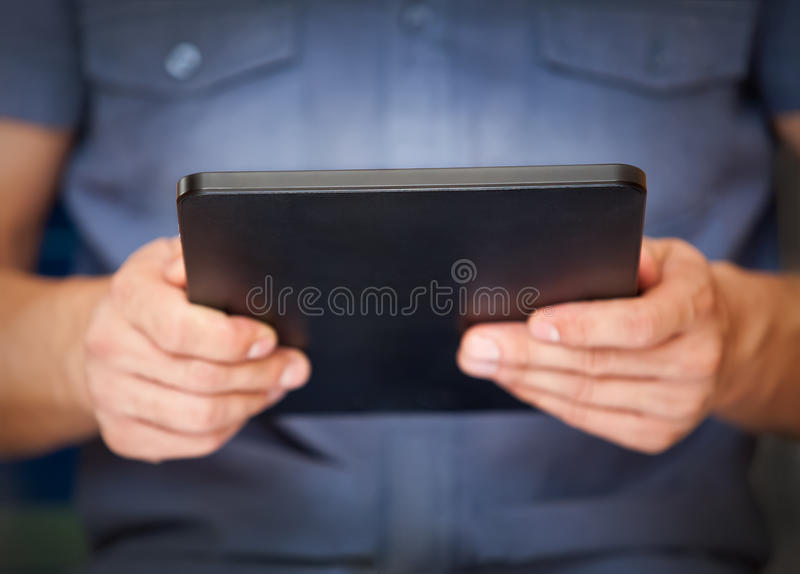 Download Close Up Of A Man Using Tablet Pc Stock Photo - Image: 26089278