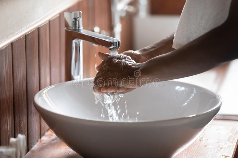 Close up of man wash hands in sink in morning stock photos