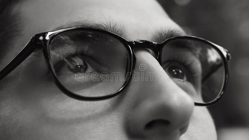 Close-up of man wearing glasses. Black and white life without sight. Healthy sight concept. royalty free stock photo