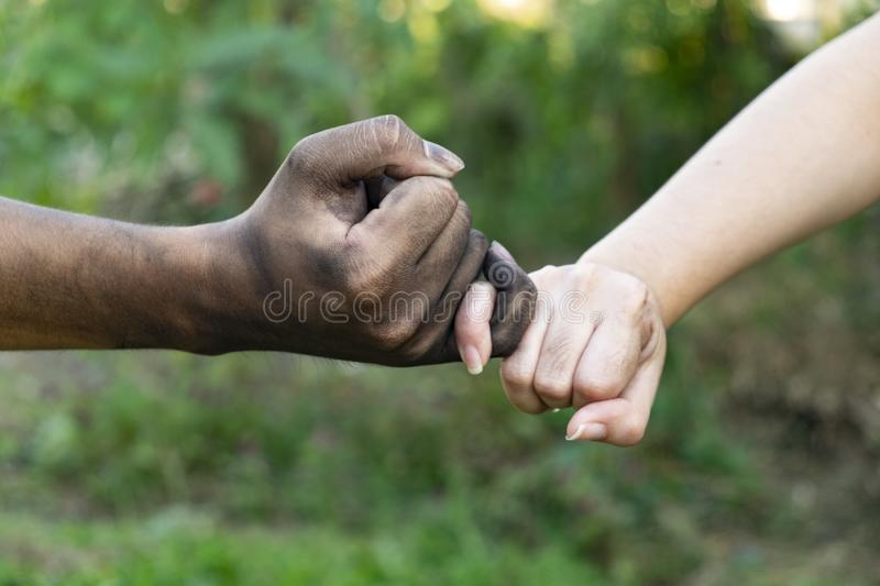 Close up man and woman hands touching holding together on blurred background for love valentine day concept, shake hand with a d. Irty hand and a clean, Stained stock photos