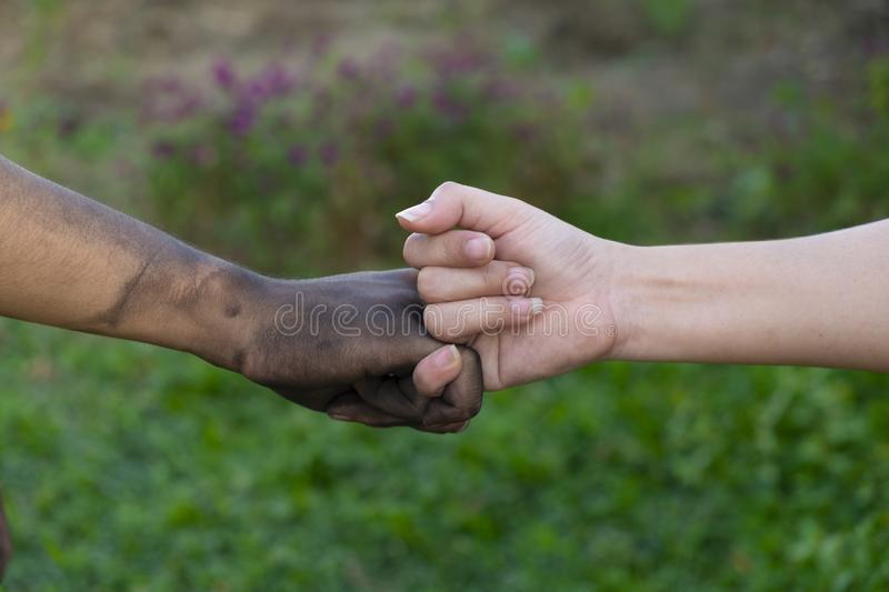 Close up man and woman hands touching holding together on blurred background for love valentine day concept, shake hand with a d. Irty hand and a clean, Stained royalty free stock images