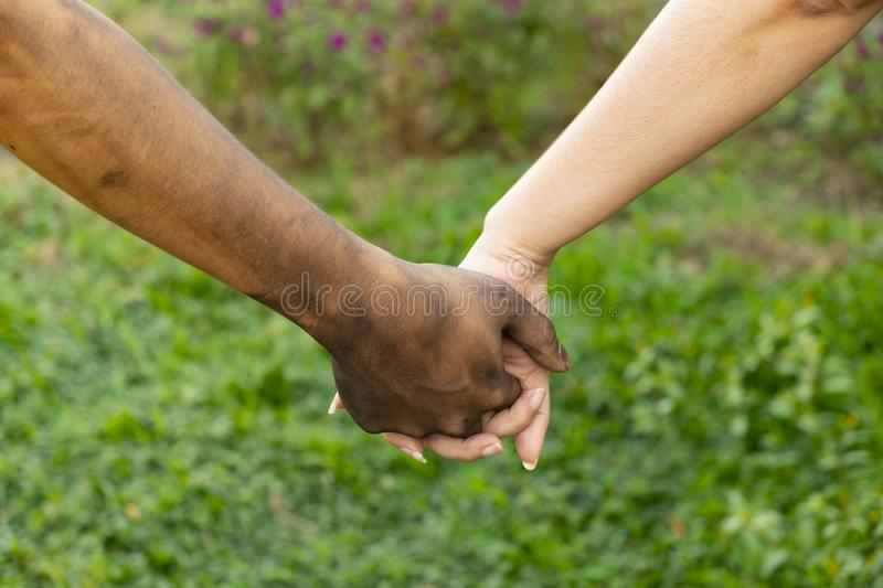 Close up man and woman hands touching holding together on blurred background for love valentine day concept, shake hand with a d. Irty hand and a clean, Stained stock images