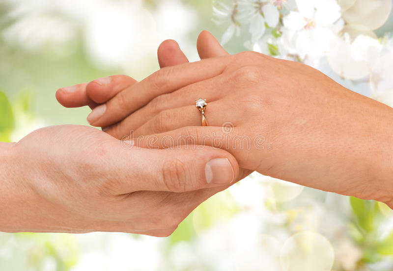 Close Up Of Man And Woman Hands With Wedding Ring Stock Image