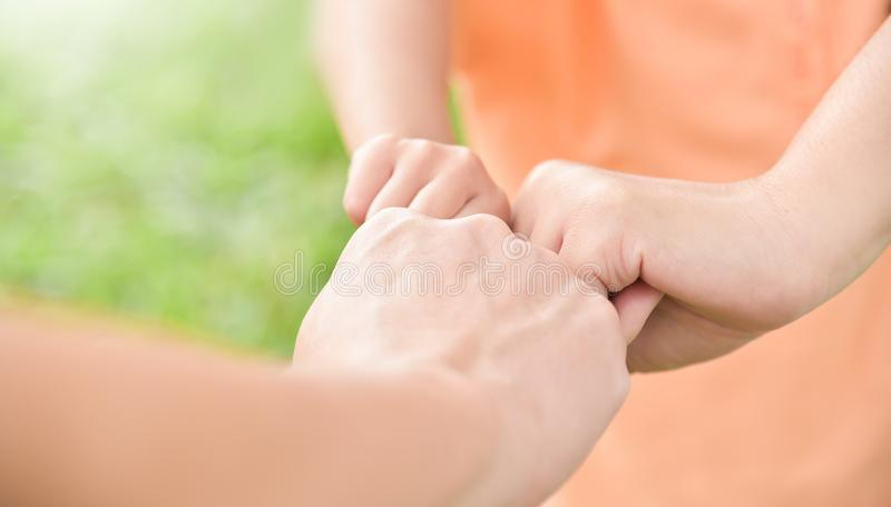 Family join hands together. royalty free stock images