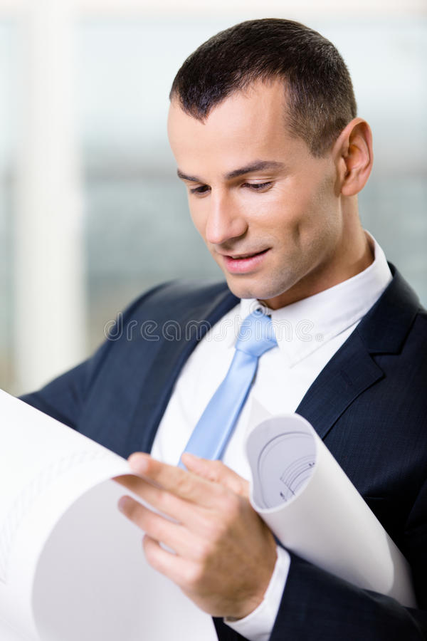 Download Close Up Of Manager With Blueprint Stock Photo - Image: 29405770