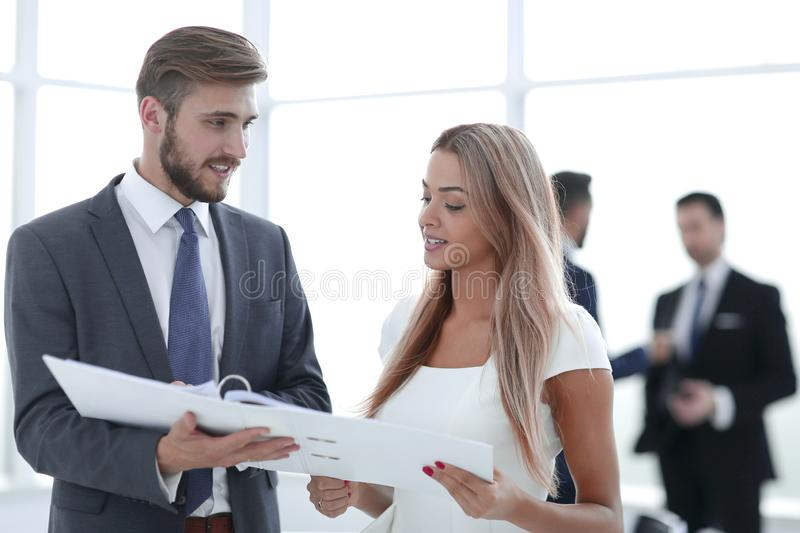Manager discussing with the client the business document stock photo