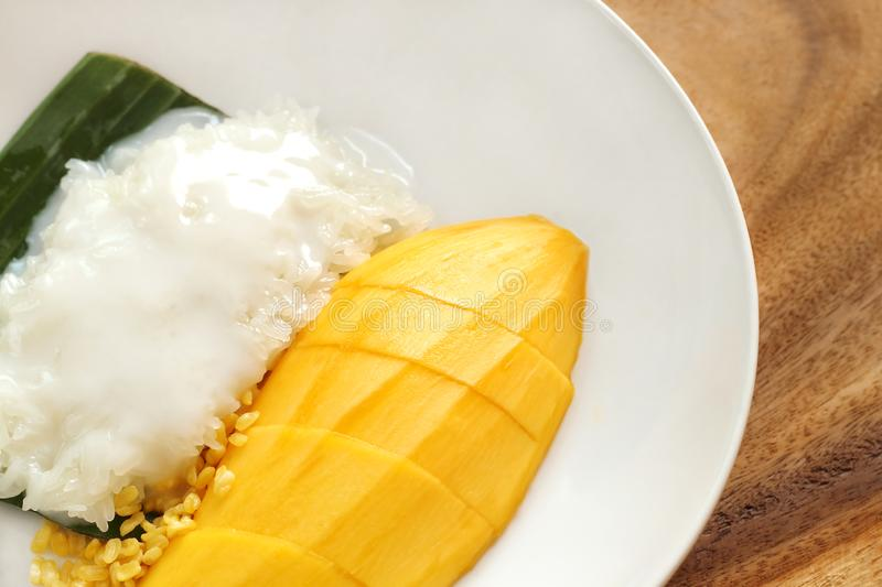 Close up of mango sticky rice on white plate, popular traditional sweet dessert of thailand royalty free stock photo