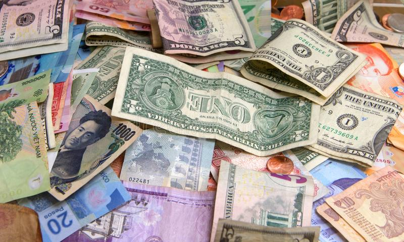 Close up on many bank notes from many countries royalty free stock photo