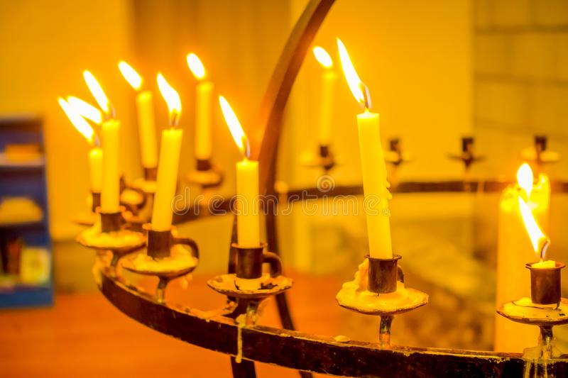 Close up of many candles over a metallic chandelier inside of the Bodo cathedral in Nordland county stock photo