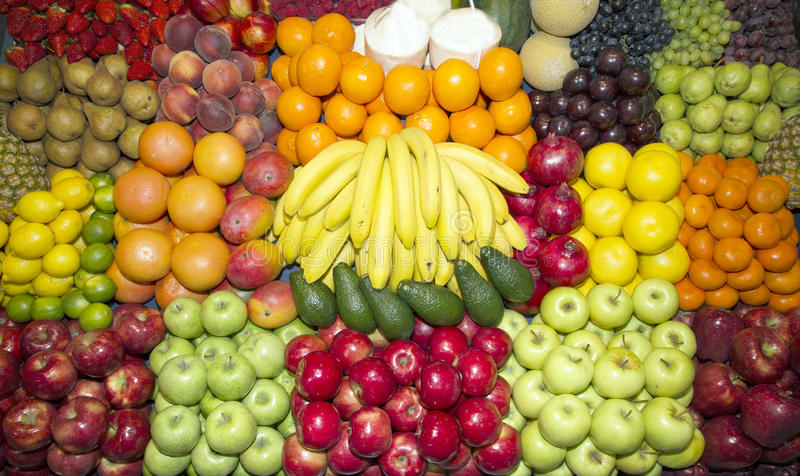 Close up of many colorful fruits on farmers market stand stock image
