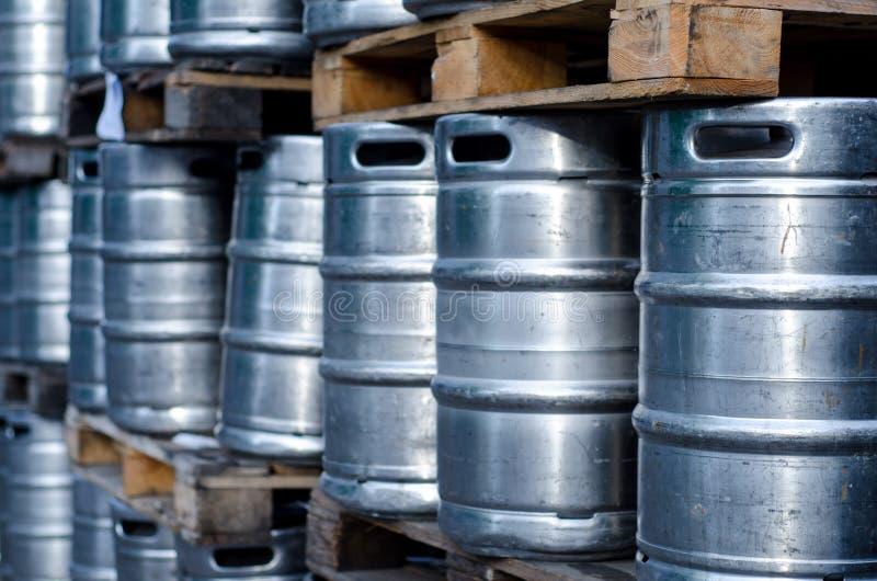 Many metal beer kegs. Close-up of many metal beer kegs stock photos