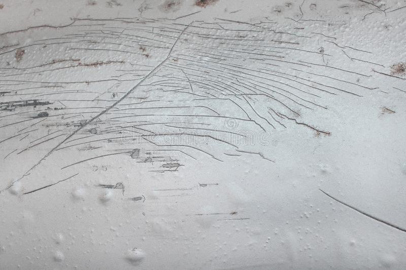 Many scratched on old blonde car with deep damage to the paint texture for background royalty free stock images