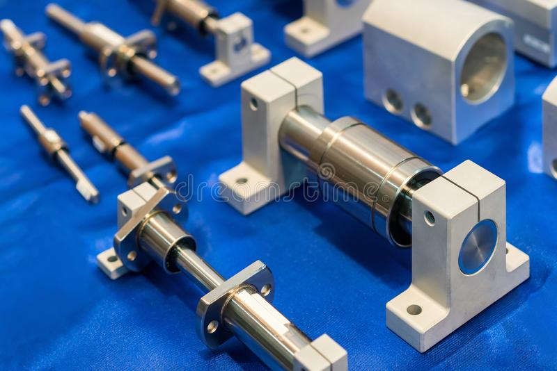 Close up many size of high quality and precision linear ball bearing guide of machine for industrial work on table.  royalty free stock image