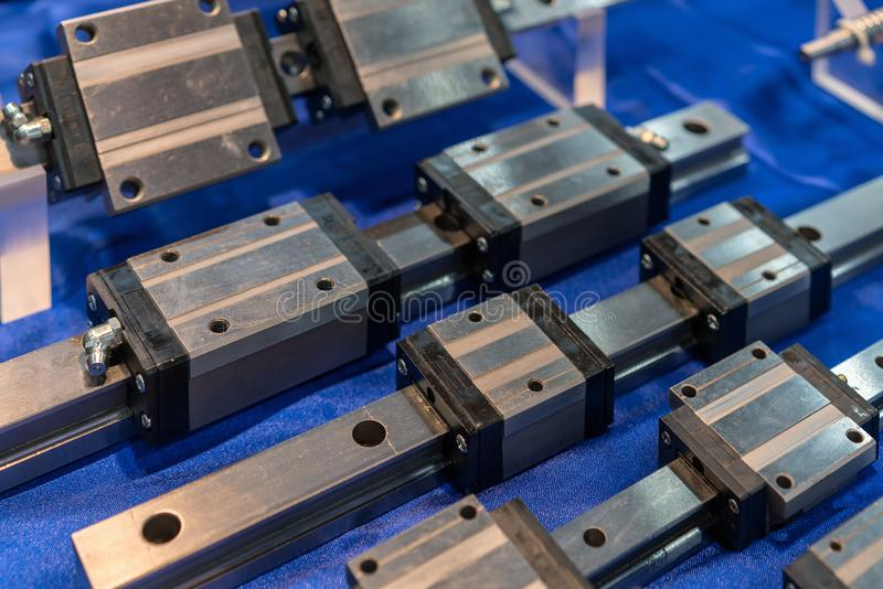 Close up many size of high quality and precision linear ball bearing guide of machine for industrial work on table.  royalty free stock photo