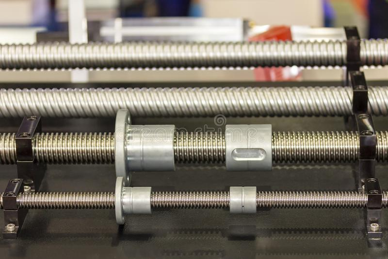 Close up many size of high quality and precision linear or lead drive of machine on table for industrial work.  stock image