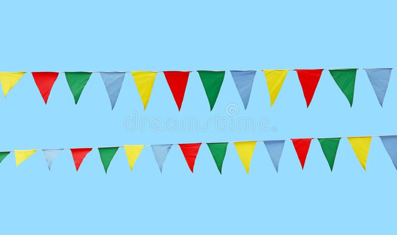 Multicolor festive flags over blue sky royalty free stock photography