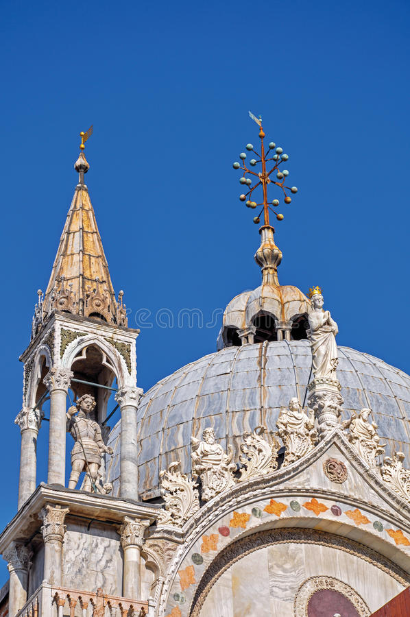 Close-up of marble sculptures and dome in typical Venetian style on the San Marco Basilica in Venice. stock photo