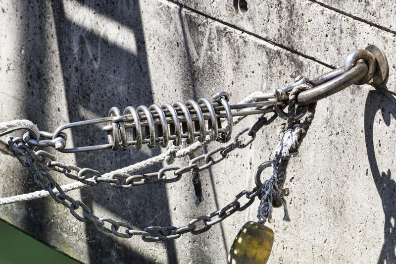 Close Up of marina mooring with shock-absorbing springs, ropes and float stock images