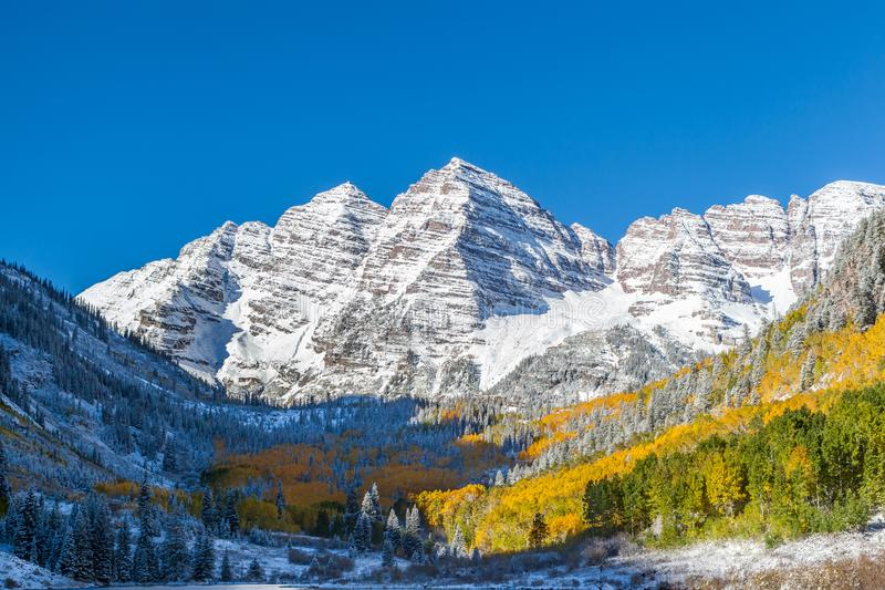 Close up Maroon Bells peaks with yellow aspen forest in Colorado. USA royalty free stock photography