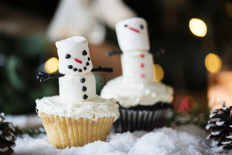 Close up of marshmallow snowman Christmas cupcake royalty free stock photos