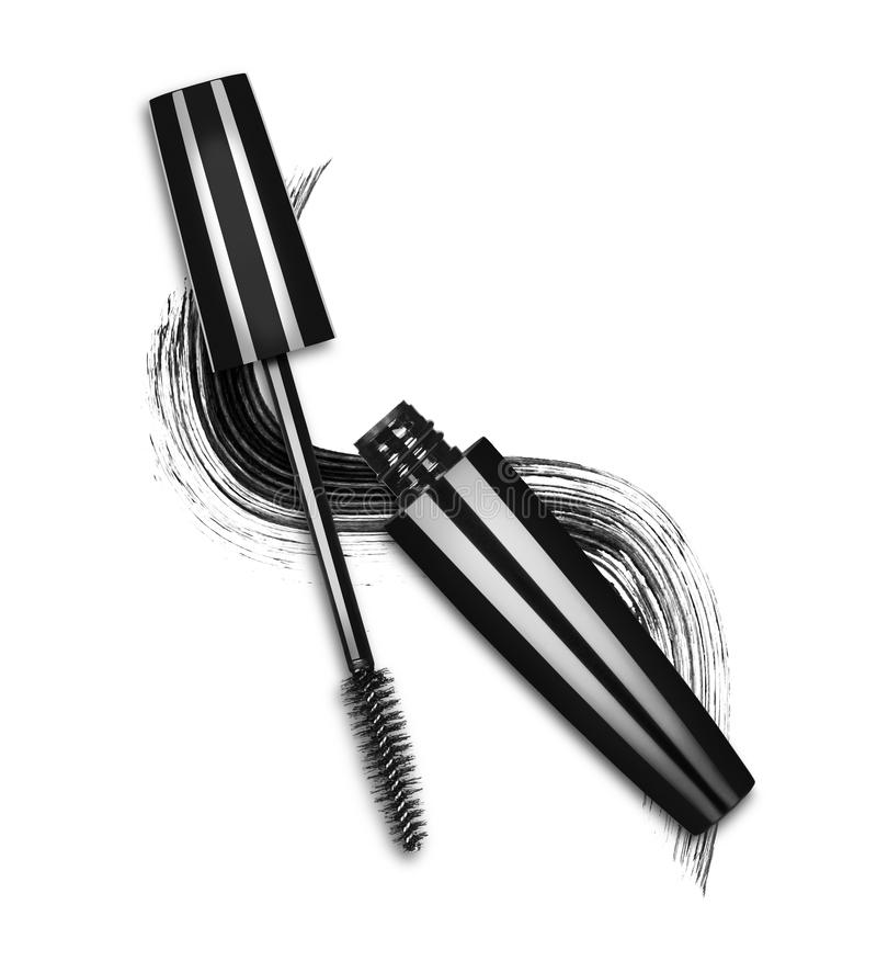 Close-up of mascara brush with black stroke on white background stock photography