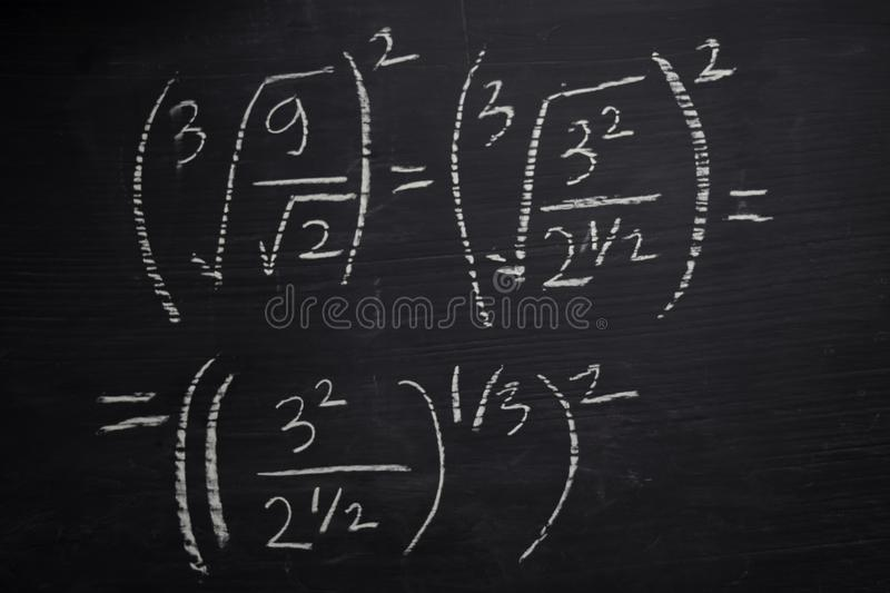 Close up math formulas written on a blackboard. Education concept royalty free stock photos