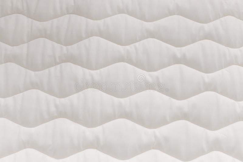 Close up mattress texture. Comfortable sleep concept. New modern mattress, for background. . royalty free stock photography