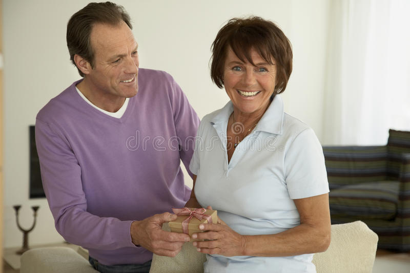 Close-up of a mature couple holding a gift royalty free stock photography