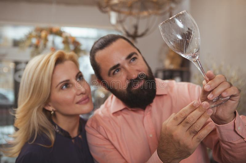 Lovely mature couple buying kitchenware at the store stock images