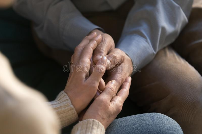 Close up of elderly couple hold hands showing love royalty free stock image